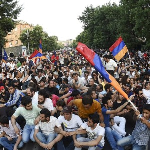 Protesters gather during rally against recent decision to raise public electricity prices in Yerevan