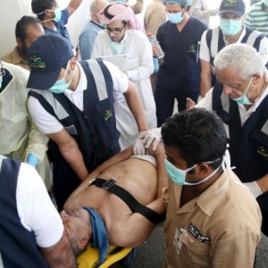Medical staff carry a way wounded pilgrim following a crush caused by large numbers of people pushing at Mina, outside the Muslim holy city of Mecca September 24, 2015. REUTERS/Stringer
