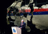 Dutch Safety Board Chairman Tjibbe Joustra speaks in front of the wrecked cockpit of the Malaysia Airlines flight MH17 exhibited during a presentation of the final report on the cause of the its crash at the Gilze Rijen airbase October 13, 2015. Air crash investigators have concluded that Malaysia Airlines flight MH17 was shot down by a missile fired from rebel-held eastern Ukraine, sources close to the inquiry said today, triggering a swift Russian denial. The findings are likely to exacerbate the tensions between Russia and the West, as ties have strained over the Ukraine conflict and Moscow's entry into the Syrian war.   AFP PHOTO / EMMANUEL DUNANDEMMANUEL DUNAND/AFP/Getty Images