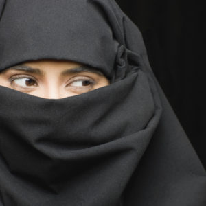 Close-up of young Indian woman wearing burka
