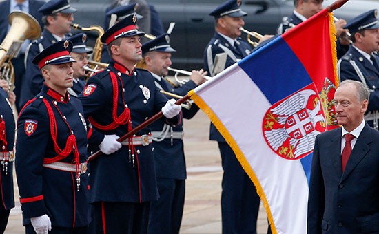 Russian Security Council Secretary Nikolai Patrushev reviews the police honor guard upon his arrival at the Serbia Palace to meet with Serbian Interior Minister Nebojsa Stefanovic, in Belgrade, Serbia, Wednesday, Oct. 26, 2016. Russia's top security official is urging closer cooperation with Serbia as part of increased efforts by Moscow to step up its influence the traditional Balkan ally seeking European Union membership. (AP Photo/Darko Vojinovic)
