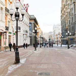 MOSCOW, RUSSIA - JANUARY 19, 2014: tourists walk on Arbat street in Moscow. Arbat has existed since the 15th century, it is pedestrian street about one km long in historical centre of Moscow