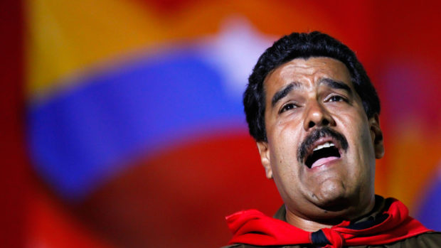 Venezuela's acting President and presidential candidate Nicolas Maduro sings during a campaign rally in Caracas April 5, 2013. Maduro said on Friday that Venezuelan authorities have arrested several people suspected of plotting to sabotage one of his campaign rallies before an April 14 election by cutting the power. REUTERS/Carlos Garcia Rawlins (VENEZUELA - Tags: POLITICS ELECTIONS) - RTXYACV