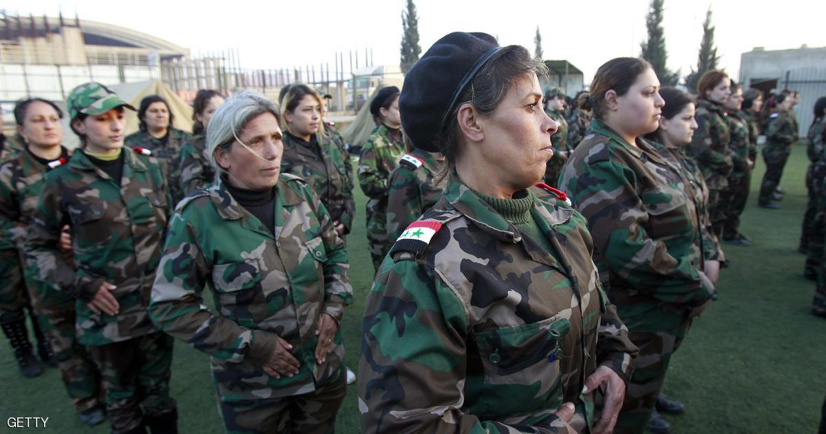 Syrian National Defense force women who just finished training, stand to attention at their training center in Wadi al-Dahab in the Syrian city of Homs, on January 21, 2013. Some 500 women are being trained and will help other National Defence force recruits at checkpoints and with other security tasks. AFP PHOTO/ANWAR AMRO (Photo credit should read ANWAR AMRO/AFP/Getty Images)