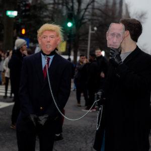January 20, 2017 - Washington, D.C - Masked anti-Trump protestors, at a Disrupt J20 rally in Washington DC, mock Trump's relationship with Russian president Vladimir Putin. (Credit Image: Global Look Press via ZUMA Press)