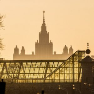 Moscow, Russia. Bogdan Khmelnitsky (Kievsky) pedestrian bridge and Moscow State University building on Vorobiyovy Gory (Sparrow Hills).