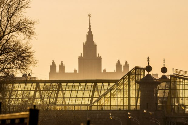 Moscow, Russia. Bogdan Khmelnitsky (Kievsky) pedestrian bridge and Moscow State University building on Vorobiyovy Gory (Sparrow Hills).