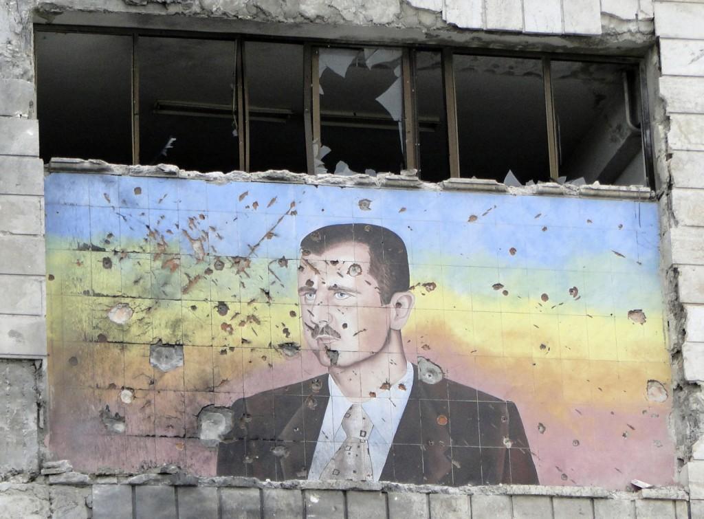 syria-bashar-bullet-holes