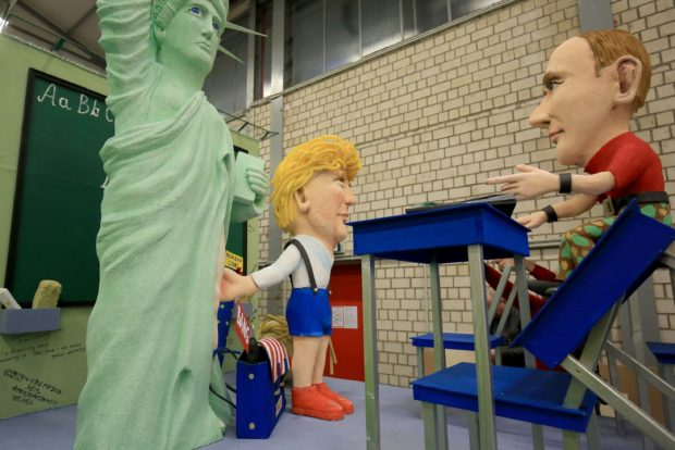 A float showing US President Donald Trump and the statue of liberty with Russian President Vladimir Putin is displayed at the presentation of the floats for the Shrove Monday Parade in the Festival Committee hall for the Cologne Carnival, in Cologne, Germany, on 21 February 2017. Photo: Oliver Berg/dpa