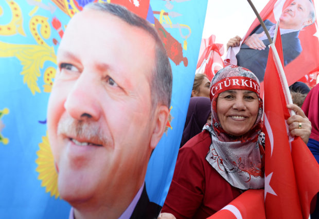 April 17, 2017 - Ankara, Trkiye - Turkey's President Recep Tayyip Erdogan and his wife Emine Erdogan addresses supporters in Presidential Palace, Ankara, Turkey April 17, 2017. Erdogan declared victory in Sunday's historic referendum that will grant sweeping powers to the presidency, hailing the result as a 'historic decision. 51.4 percent of voters had sided with the 'Yes' campaign, ushering in the most radical change to the country's political system in modern times. Turkey's main opposition calls on top election board to annul the referendum. OSCE observers said that a Turkish electoral board decision to allow as valid ballots that did not bear official stamps undermined important safeguards against fraud (Credit Image: Global Look Press via ZUMA Press)
